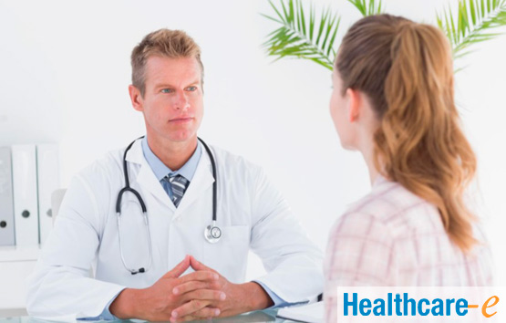 female patient speaking to doctor about PID